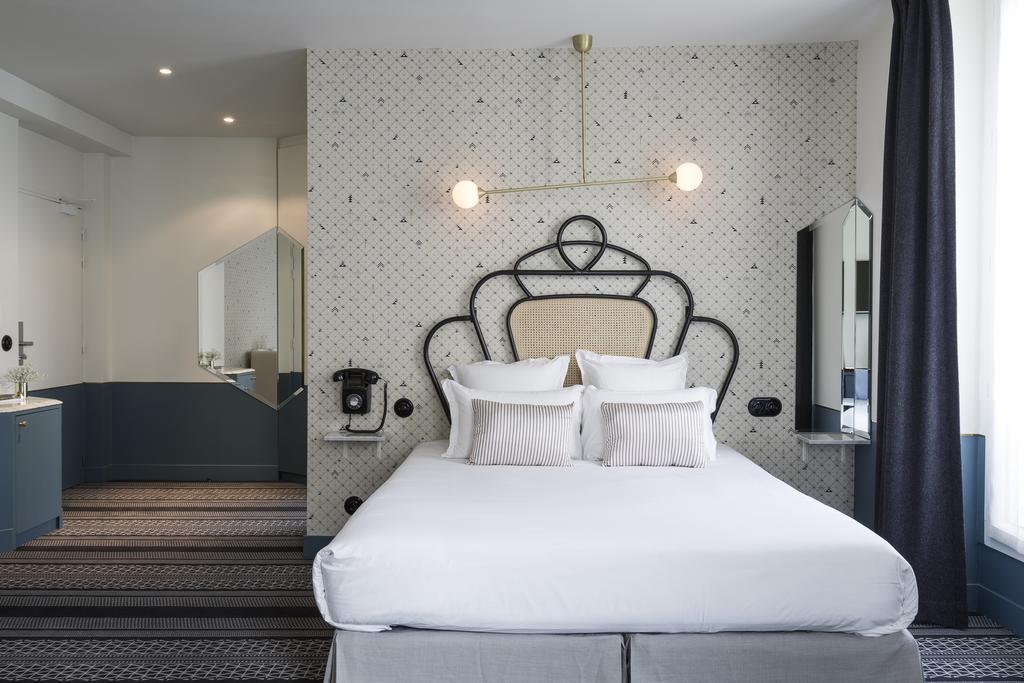 Hotel Panache slaapkamer wit bed Puur Parijs